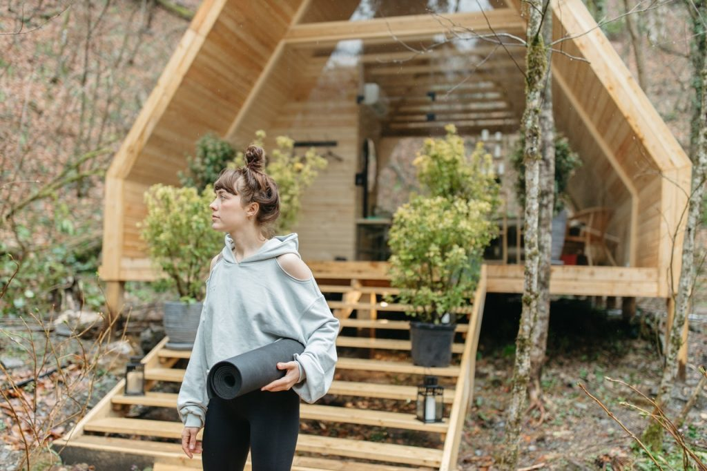 woman in front of glamping tent